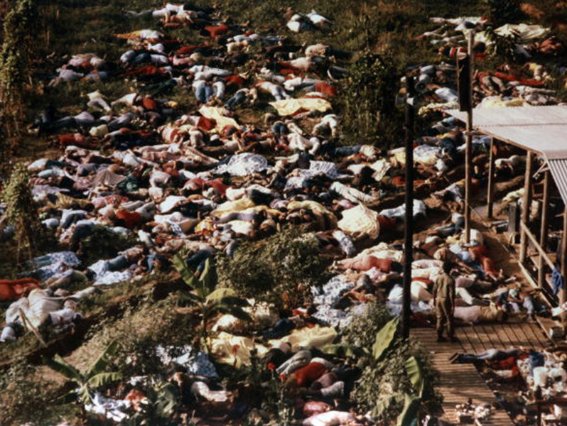 1978: People lie on the ground dead from forced suicide.